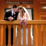 Bride and groom on the balcony over the Grand Sequoia Ballroom at Tewksbury Country Club, Tewksbury, MA.