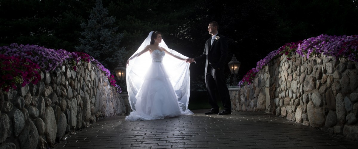 Bride and Groom on the Bridge at Night