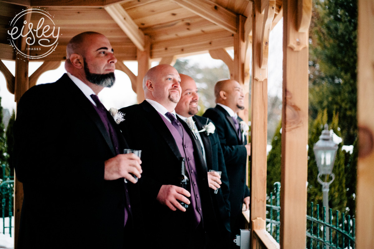 Groom and friends enjoy a relaxing moment on the porch